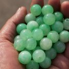 Green jade beads, a single diameter of about 13 mm (40 to a pack)