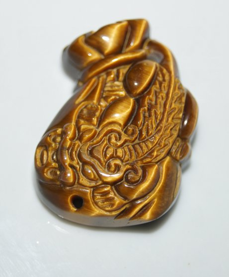 Natural tigereye purse type wing the mythical wild animal. Talisman necklace pendant