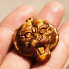 Natural tigereye Manual sculpture. Talisman necklace pendant