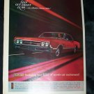 Vintage 1965 OLDSMOBILE Olds Red Rocket Action Print Ad