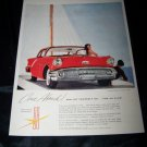 Vintage 1957 Oldsmobile Golden Rocket Holiday Print Ad