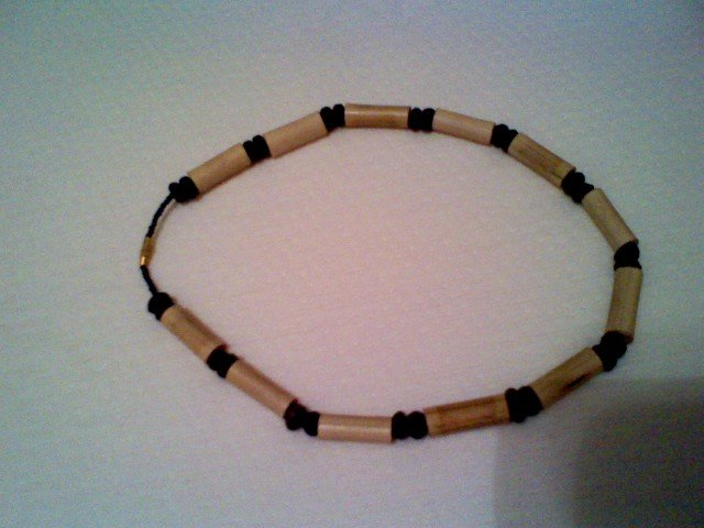 Ivory and black African neck ornaments.