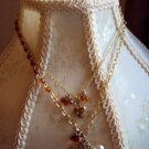 Custom necklace w/amber and clear beads, clover, and lockets