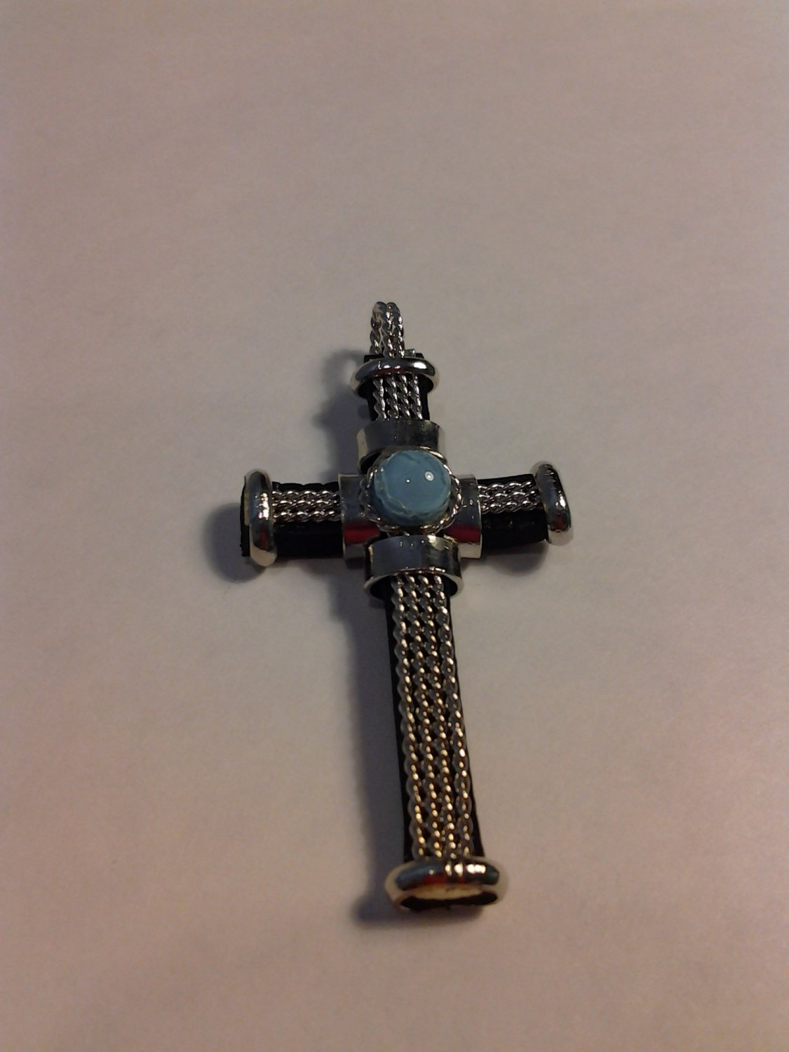 Brand New Beautiful Pendant Cross with a light blue Stone in the middle
