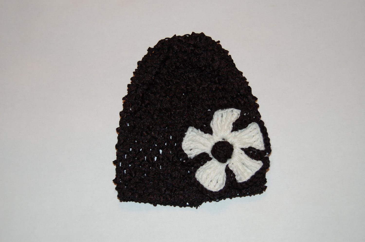 Crocheted Black Hat with White Crocheted Flower