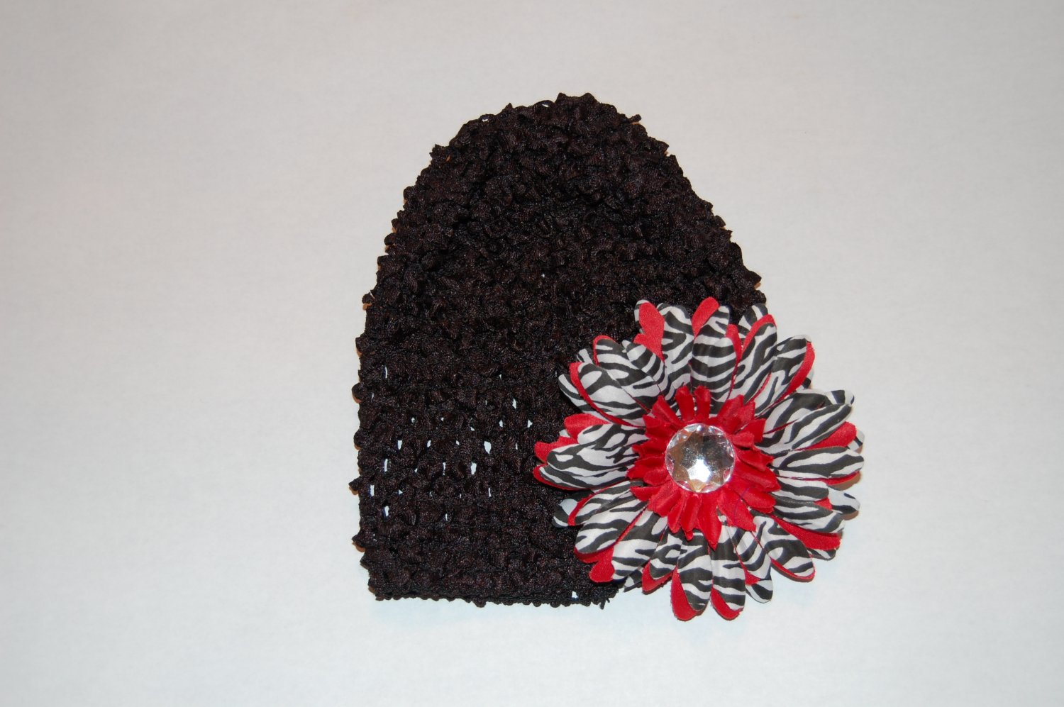 Crocheted Black Hat with Red Stacked Zebra Daisy