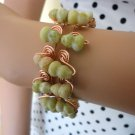 Geraldine - copper wire and natural peridot bracelet