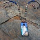 Winifred - lampwork, lapis lazuli, rainbow calsilica, bronze wire, Ethiopian metal bead necklace