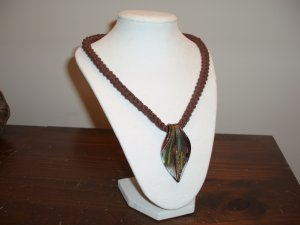 Crocheted necklace cord with glass pendant