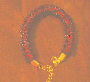 Pomegranate red and gold kumihimo beaded bracelet with lobster claw