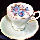 Light blue teacup and saucer, made by Royal Grafton Fine Bone China