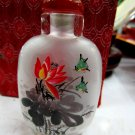 Delicate glass painting lotus snuff bottle