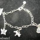 Silver Tone Charm Bracelet Signed High Intensity scottie dog, horse, locket
