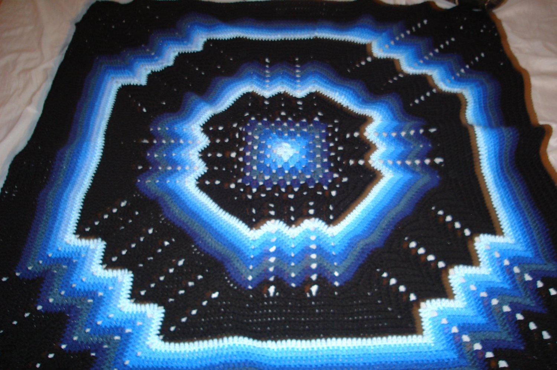 multi-colored blue & black afghan