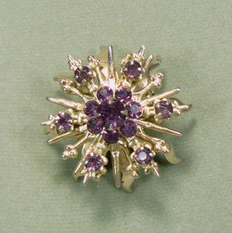 *Sunburst-shaped Soft Goldtone Brooch Sparked with Pretty Purple Rhinestones