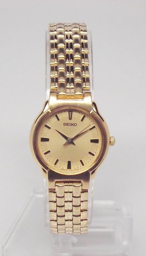 Seiko Womens Gold Tone Gold Dial Watch SFW830