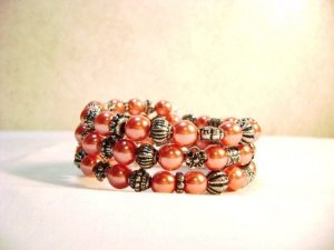 "Light Cranberry Glass Pearl and ""antiqued"" beaded memory wire bracelet"