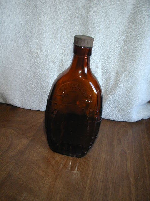 "Brown Glass One Pint Bottle 8 3/4"" tall"