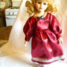 "Porcelain Doll with Stand in Maroon Dress with White Lace 15"" Tall"