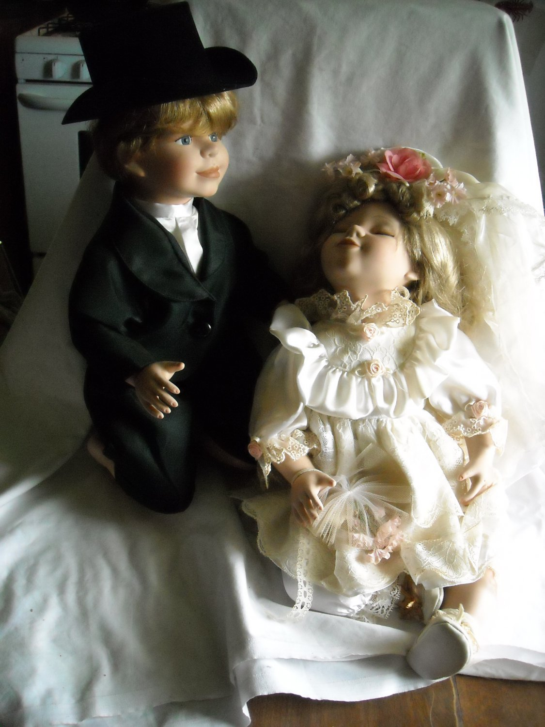 "Bride 17"" tall and Groom 15"" Kneeling Porcelain Dolls"
