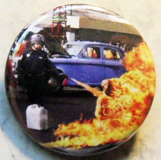 "PEPPER SPRAY COP SPRAYS A MONK pinback button badge 1.25"""