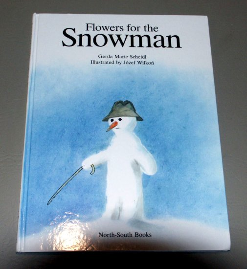Flowers for the Snowman (A North-South picture book) by Gerda Marie Scheidl
