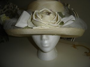 ENCHANTING OFF WHITE MESH HAT WRAPPED IN TULLE WITH A STRIKING BEIGE SILK FLOWER!
