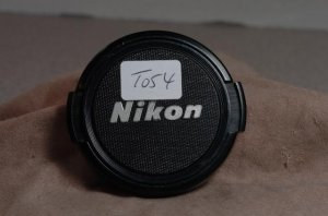 Original genuine Nikon 52mm front lens cap  T054