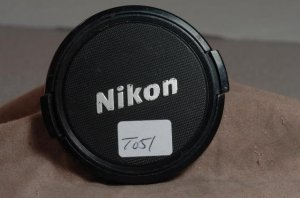 Original genuine Nikon 62mm front lens cap  T051