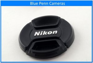 Original genuine Nikon 58mm center pinched lens cap