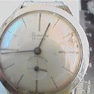 OLD aluminum case genova delux windup watch runs 4U2FIX