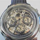 UNUSUAL SKELETON TRIPLE DIAL WANLIXING AUTO WATCH RUNS