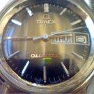 VINTAGE 1977 STEEL BACK TIMEX DATE QUARTZ WATCH RUNS
