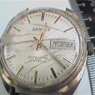 VINTAGE BENRUS AUTOMATIC DAY DATE WATCH RUNS NEEDS GLAS