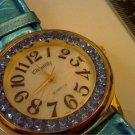 CLOLORFUL BLUE STONE BEZEL LADIES CHANTILLY WATCH RUNS