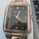 unusual stone on black dial bill blass quartz watch run