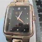 unusual stone on black dial bill blass quartz watch run