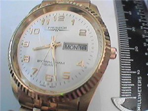 CLEAN PRESTIGE BY WALTHAM DAY DATE QUARTZ WATCH RUNS