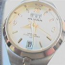 UNUSUAL DAY DATE MILAN LADIES QUARTZ WATCH 100FT WR