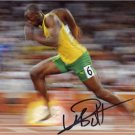 OLYMPIC TRACK STAR USAIN BOLT SIGNED PHOTO 8X10 RP AUTO AUTOGRAPHED 2012 LONDON