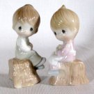 Enesco Precious Moments Girl and Boy On Stump Salt & Pepper Shakers