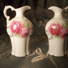 A pair of porcelain vintage antiques small floral pitchers