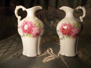 A pair of porcelain vintage antiques small floral pitchers