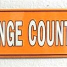 NCAA University of Tennessee Volunteers Big Orange County Embossed Metal Arrow Signs