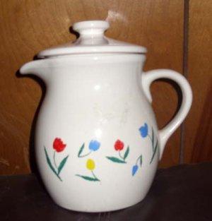 White glazed stoneware pitcher with tulips