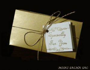 Gold box with card