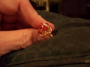 Garnet Swirled In Gold Ring