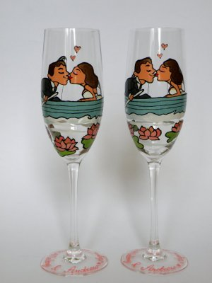 Champagne glasses Groom and Bride on Boat pink waterlilies around them