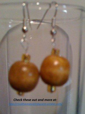 Dangle earrings with light wood beads