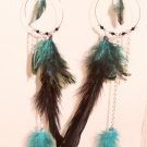 Feather Earrings with multiple blue feathers, beads, chains and a feather centerpiece